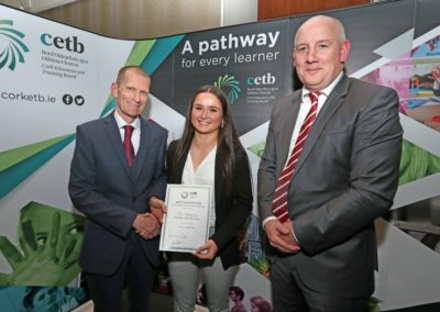 GCC student Zoe Littlejohns receiving her Student of the Year award from Mr John Fitzgibbons Acting Chief Executive & Director of Further Education and Training Cork ETB. Also pictured is GCC Principal Ronan McCarthy