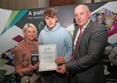 GCC student James Walsh receiving the The Riobeard Ó Buachalla Medal for achieving 601 points in the 2018 Leaving Certificate from Ms Suzanne Mullins Director of Organisation Support and Development Cork ETB. Also pictured is GCC Principal Ronan McCarthy.