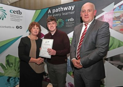GCC student Robbie Callaghan receiving a Special Commendation Certificate for achieving 555 points in the 2018 Leaving Certificate from Ms Sheila Quill Director of Organisation Support & Development Cork ETB. Also pictured is GCC Principal Ronan McCarthy.
