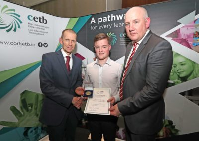 GCC student Fergal Buckley receiving the The Diarmuid Ó Longaigh Medal for achieving 578 points in the 2018 Leaving Certificate from Mr John Fitzgibbons Acting Chief Executive & Director of Further Education and Training Cork ETB. Also pictured is GCC Principal Ronan McCarthy.