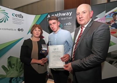 GCC student Shane Crowe receiving The Dick Langford Medal for achieving 589 points in the 2018 Leaving Certificate from Ms Sheila Quill Director of Organisation Support & Development Cork ETB. Also pictured is GCC Principal Ronan McCarthy.